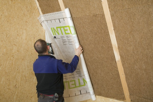 Intello airtight membrane being applied over Thermo Hemp insulation