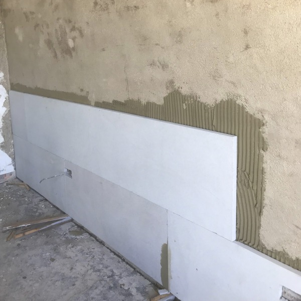 Calsitherm Climate Board installed onto a wall levelled with Diathonite Thermal Plaster