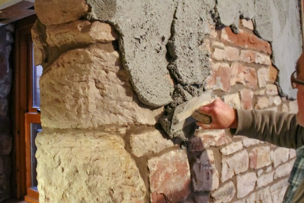 Deumix being appiled with a hand trowel to brick facing