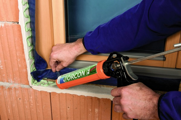 Orcon F being applied to an airtight membrane around a window cill.