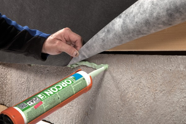 Orcon F being used to seal Solitex Fronta Quattro to masonry