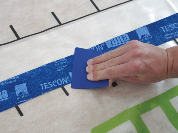 Tescon Vana being smoothed over on an Intello membrane using a Pressfix tool